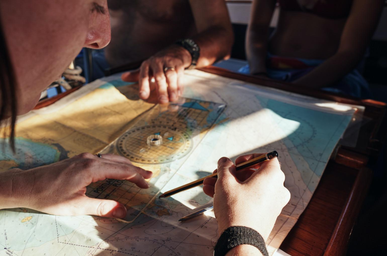 Women mapping sea chart